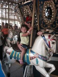 J.J. and Kyeli on the carousel